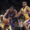 Oklahoma City Thunder forward Kevin Durant, center, is pressured by Los Angeles Lakers\' Ron Artest, left, and Andrew Bynum during the first half of Game 2 in a first-round NBA basketball playoff series in Los Angeles, Tuesday, April 20, 2010. (AP Photo/Jae C. Hong) ORG XMIT: LAS204
