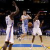 Denver\'s Danilo Gallinari (8) loses control of the ball between Oklahoma City\'s Serge Ibaka (9) and Kevin Durant (35) during the NBA basketball game between the Denver Nuggets and the Oklahoma City Thunder in the first round of the NBA playoffs at the Oklahoma City Arena, Sunday, April 17, 2011. Photo by Bryan Terry, The Oklahoman