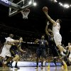 Photo - Texas' Javan Felix (3) shoots during the first half of an NCAA college basketball game against West Virginia in the Big 12 men's tournament on Thursday, March 13, 2014, in Kansas City, Mo. (AP Photo/Charlie Riedel)