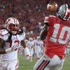 Photo - Ohio State wide receiver Corey Brown, catches a touchdown pass as Wisconsin safety Dezmen Southward defends during the second quarter of an NCAA college football game Saturday, Sept. 28, 2013, in Columbus, Ohio. (AP Photo/Jay LaPrete)