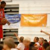 Basketball camp participants help line Kevin Durant up for a behind the back half-court shot. Kevin Durant held a basketball camp Wednesday, June 30, 2010, at Heritage Hall in Oklahoma City. Photo by Mitchell Alcala, The Oklahoman.