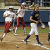 OU\'s Erica Sampson (63) scores in front of teammate Brianna Turang (2) near Michigan pitcher Sara Driesenga (10) and catcher Lauren Sweet (25) in the fifth inning during an NCAA softball game in the Women\'s College World Series between Oklahoma and Michigan at ASA Hall of Fame Stadium, Thursday, May 30, 2013. OU won, 7-1. Photo by Nate Billings, The Oklahoman