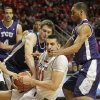Photo - Texas Tech's Dejan Kravic vies for a rebound against TCU's Hudson Price, left, and Clyde Smith III during an NCAA college basketball game in Lubbock, Texas, Saturday, Feb, 1, 2014. (AP Photo/Lubbock Avalanche-Journal, Tori Eichberger) LOCAL TV OUT