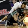 Kansas State forward Adrian Diaz (20) knocks the ball away from South Carolina Upstate forward Rob Elam, bottom, during the first half of an NCAA college basketball game on Sunday, Dec. 2, 2012, in Manhattan, Kan. (AP Photo/Charlie Riedel)
