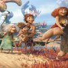 This film publicity image released by DreamWorks Animation shows, from left, Thunk, voiced by Clark Duke, Gran, voiced by Cloris Leachman, Ugga, voiced by Catherine Keener, who is holding Sandy, voiced by Randy Thom, Eep, voiced by Emma Stone and Grug, voiced by Nicolas Cage, in a scene from