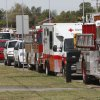 Fire and emergency vehicles line the road during the funeral of slain Nichols Hills Fire Chief Keith Bryan at the Bridge Assembly of God in Mustang, OK, Saturday, Sept. 24, 2011. By Paul Hellstern, The Oklahoman