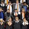 Members of the Oklahoma State family join arm in arm to sing the alma mater during the memorial service for Oklahoma State head basketball coach Kurt Budke and assistant coach Miranda Serna at Gallagher-Iba Arena on Monday, Nov. 21, 2011 in Stillwater, Okla. The two were killed in a plane crash along with former state senator Olin Branstetter and his wife Paula while on a recruiting trip in central Arkansas last Thursday. Photo by Chris Landsberger, The Oklahoman