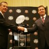 Photo - UNIVERSITY OF OKLAHOMA / OU / COLLEGE FOOTBALL / BCS NATIONAL CHAMPIONSHIP GAME / BOWL GAME / BOWL CHAMPIONSHIP SERIES: Florida head coach Urban Meyer, left, and Oklahoma head coach Bob Stoops shake hands in front of the BCS championship trophy during a press conference in Ft. Lauderdale, Fla., Wednesday, Jan. 7, 2009. Oklahoma will play Florida for the NCAA BCS football championship Thursday, Jan. 8. (AP Photo/J. Pat Carter) ORG XMIT: BCS105