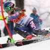 Photo - United States' Mikaela Shiffrin skis past a gate during the women's slalom at the Sochi 2014 Winter Olympics, Friday, Feb. 21, 2014, in Krasnaya Polyana, Russia. (AP Photo/Alessandro Trovati)