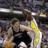 Brooklyn Nets center Brook Lopez, left, works against Indiana Pacers center Roy Hibbert in the first half of an NBA basketball game in Indianapolis, Monday, Feb. 11, 2013. (AP Photo/Michael Conroy)