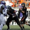 Oklahoma State\'s Wes Lunt (11) looks to throw a pass during a college football game between Oklahoma State University (OSU) and Texas Christian University (TCU) at Boone Pickens Stadium in Stillwater, Okla., Saturday, Oct. 27, 2012. Photo by Sarah Phipps, The Oklahoman