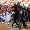 Oklahoma State celebrates a Charlie Moore (17) touchdown during a college football game between Oklahoma State University (OSU) and Texas Christian University (TCU) at Boone Pickens Stadium in Stillwater, Okla., Saturday, Oct. 27, 2012. Photo by Sarah Phipps, The Oklahoman