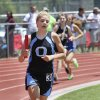 Photo - Claire Haffner of Okeene wins the final leg of the 3200 meter relay at Carl Albert high school in Midwest City, Friday May 09, 2014. Photo By Steve Gooch, The Oklahoman