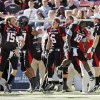 From left, Texas Tech\'s Taylor Potts (15), Brian Duncan (57), Austin Zouzalik (6), Harrison Jeffers (10) and Seth Doege (7) jump on the sidelines as the song
