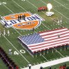 UNIVERSITY OF MISSISSIPPI: The American flag is presented before the Cotton Bowl Classic college football game between the Oklahoma State University Cowboys (OSU) and the Ole Miss Rebels at Cowboys Stadium in Arlington, Texas, Saturday, January 2, 2010. Photo by Sarah Phipps, The Oklahoman ORG XMIT: KOD