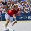 Photo -   Ryan Harrison returns a shot to Argentina's Juan Martin Del Potro in the third round of play at the 2012 US Open tennis tournament, Friday, Aug. 31, 2012, in New York. (AP Photo/Paul Bereswill)