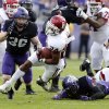 Oklahoma\'s Brennan Clay (24) runs during the college football game between the University of Oklahoma Sooners (OU) and the Texas Christian University Horned Frogs (TCU) at Amon G. Carter Stadium in Fort Worth, Texas, on Saturday, Dec. 1, 2012. Photo by Steve Sisney, The Oklahoman