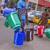 Photo - Water bucket sellers hawk their wares as the public buy them to try to protect them selves from the deadly Ebola virus in Monrovia, Liberia, Wednesday, Aug. 6, 2014. The price of buckets has increased as Liberian people are encouraged to wash their hands after filling it with disinfectant to prevent the spread of the deadly Ebola virus. The World Health Organization has begun an emergency meeting on the Ebola crisis, and said at least 932 deaths in four African countries are blamed on the virus, with many hundreds more being treated in quarantine conditions.  (AP Photo/Abbas Dulleh)