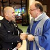 Father Dan J. Latourneau thanks Edmond police officer Jeff Morefield at the Blue Mass, to honor officers who lost their life in the line of duty at the Catholic Parish of St. John the Baptist in Edmond Saturday, May 15, 2010. Photo by Doug Hoke, The Oklahoman.