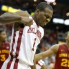 Oklahoma\'s Sam Grooms (1) reaches to a play during the Phillips 66 Big 12 Men\'s basketball championship tournament game between the University of Oklahoma and Iowa State at the Sprint Center in Kansas City, Thursday, March 14, 2013. Photo by Sarah Phipps, The Oklahoman
