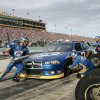 Brad Keselowski\'s pit crew services his car during the NASCAR Sprint Cup Series auto race at Homestead-Miami Speedway, Sunday, Nov. 18, 2012, in Homestead, Fla. (AP Photo/The Miami Herald, Andrew Uloza) MAGS OUT