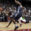 Photo - Temple's Will Cummings (2) turns the ball over while Villanova's James Bell defends during the second half of an NCAA college basketball game on Sunday, Feb. 1, 2014, in Philadelphia. Villanova beat Temple 90-74. (AP Photo/Michael Perez)