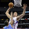 Los Angeles Clippers forward Blake Griffin goes up for a dunk as Denver Nuggets guard Arron Afflalo defends during the first half of an NBA basketball game, Wednesday, Jan. 5, 2011, in Los Angeles. (AP Photo/Mark J. Terrill)