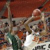 Oklahoma State \'s Marcus Smart (33) puts up a shot pst South Florida Bulls\' Martino Brock (0) during the college basketball game between Oklahoma State University (OSU) and the University of South Florida (USF) on Wednesday , Dec. 5, 2012, in Stillwater, Okla. Photo by Chris Landsberger, The Oklahoman