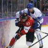 Photo - Canada forward Sidney Crosby battles against Finland defenseman Ossi Vaananen in the third period of a men's ice hockey game at the 2014 Winter Olympics, Sunday, Feb. 16, 2014, in Sochi, Russia. (AP Photo/Mark Humphrey)