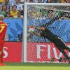 Photo - Argentina's goalkeeper Sergio Romero makes a save from Belgium's Kevin De Bruyne during the World Cup quarterfinal soccer match between Argentina and Belgium at the Estadio Nacional in Brasilia, Brazil, Saturday, July 5, 2014. (AP Photo/Frank Augstein)