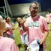 Volunteer coach Matt Allen jokes with his daughter, Taylor, left, Nicole Frazier, and Katie Kooley after icing from a cupcake was smeared on his face following a Bishop McGuinness softball game in Oklahoma City, Tuesday, Sept. 14, 2011. Allen was diagnosed with brain cancer two years ago and continues his volunteer coaching duties with the softball team. Win-Win Week is a statewide effort by Oklahoma high schools to support cancer awareness. Photo by Bryan Terry, The Oklahoman