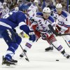 New York Rangers center Brad Richards (19) carries the puck towards Tampa Bay Lightning defenseman Sami Salo (6), of Finland, during the first period of an NHL hockey game Saturday, Feb. 2, 2013, in Tampa, Fla. Rangers\' Michael Del Zotto (4) trails the play. (AP Photo/Chris O\'Meara)