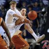 Photo - Kansas State guard Will Spradling (55) knocks the ball away from Texas guard Javan Felix (3) during the first half of an NCAA college basketball game in Manhattan, Kan., Wednesday, Jan. 30, 2013. (AP Photo/Orlin Wagner)