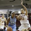 Photo - North Carolina forward Xylina McDaniel (34) drives toward the basket past Boston College forward Alexa Coulombe (13) in the first half of an NCAA college basketball game on Sunday, Jan. 19, 2014, in Boston. (AP Photo/Steven Senne)