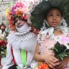 Dinah King, 6, of the Queens borough of New York, foreground right, and a man calling himself Muffinhead, foreground left, pose for photographers as they take part in the Easter Parade along New York\'s Fifth Avenue Sunday April 24, 2011. (AP Photo/Tina Fineberg)