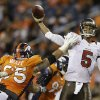 Photo - Tampa Bay Buccaneers quarterback Josh Freeman (5) throws against pressure from Denver Broncos defensive end Derek Wolfe (95) in the fourth quarter of an NFL football game, Sunday, Dec. 2, 2012, in Denver. Denver won 31-23 and clinched the AFC West division. (AP Photo/Joe Mahoney)