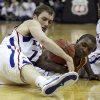 Kansas guard Brady Morningstar, left, and Texas guard/forward Jordan Hamilton (3) battle for the ball during the second half of an NCAA college basketball game for the championship of the Big 12 men\'s basketball tournament on Saturday, March 12, 2011, in Kansas City, Mo. (AP Photo/Charlie Riedel)