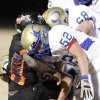 Oologah\'s Kole Koenig goes after the ball after Douglass\' Diontay Washington, at left, fumbled the ball during a high school football playoff game in Oklahoma City, Friday, Nov. 19, 2010. Oologah recovered the ball on the play. Photo by Bryan Terry, The Oklahoman