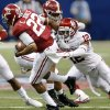 Oklahoma\'s Derrick Woods (12) stops Alabama\'s Christion Jones (22) on a kick return during the NCAA football BCS Sugar Bowl game between the University of Oklahoma Sooners (OU) and the University of Alabama Crimson Tide (UA) at the Superdome in New Orleans, La., Thursday, Jan. 2, 2014. .Photo by Chris Landsberger, The Oklahoman