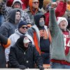 A Sooner fan celebrates a touchdown during the Bedlam college football game between the Oklahoma State University Cowboys (OSU) and the University of Oklahoma Sooners (OU) at Boone Pickens Stadium in Stillwater, Okla., Saturday, Dec. 7, 2013. Photo by Chris Landsberger, The Oklahoman