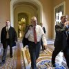 Senate Minority Whip Jon Kyl of Arizona walks between the Senate chamber and the office of Senate Minority Leader Mitch McConnell of Kentucky, as Democrats and Republicans try to negotiate a legislative path to avoid the so-called