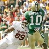 Photo - OU's Cordero Moore hits Baylor's Robert Griffinin after he threw the ball in the first half during the college football game between Oklahoma (OU) and Baylor University at Floyd Casey Stadium in Waco, Texas, Saturday, October 4, 2008.   BY BRYAN TERRY, THE OKLAHOMAN