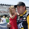 Photo - Driver Ryan Newman holds his daughter Brooklyn in the pits before the NASCAR Sprint Cup Series Pocono 400 auto race at Pocono Raceway on Sunday, June 8, 2014, in Long Pond, Pa. (AP Photo/Mike Groll)
