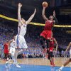 Miami\'s Dwyane Wade (3) shoots over Oklahoma City\'s Nick Collison (4) during Game 1 of the NBA Finals between the Oklahoma City Thunder and the Miami Heat at Chesapeake Energy Arena in Oklahoma City, Tuesday, June 12, 2012. Photo by Chris Landsberger, The Oklahoman