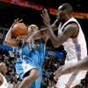 Oklahoma City\'s Johan Petro fouls Devin Brown of New Orleans during the NBA basketball game between the Oklahoma City Thunder and the New Orleans Hornets at the Ford Center in Oklahoma City on Friday, Nov. 21, 2008. BY BRYAN TERRY, THE OKLAHOMAN \