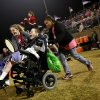 Chris Schatz reacts as he is pushed onto the field by nurse Sydney Stell, right, and music therapist Rachel Nowels at halftime of the high school football game between Bethany and Washington in Bethany, Okla., on Friday, September 16, 2011. Residents of The Children\'s Center played drums with the high school bands from Washington and Bethany. Photo by John Clanton, The Oklahoman