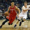 Photo - Houston Rockets guard Jeremy Lin (7) drives past Phoenix Suns guard Goran Dragic (1) in the second quarter of an NBA basketball game, Sunday, Feb. 23, 2014, in Phoenix. (AP Photo/Rick Scuteri)