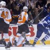 Toronto Maple Leafs\' Joffrey Lupul (19) celebrates after scoring the game winning overtime goal as Philadelphia Flyers\' Mark Streit (32) looks over at Flyers\' Vincent Lecavalier during an NHL hockey game, Saturday, March 8, 2014 in Toronto. (AP Photo/The Canadian Press, Chris Young)