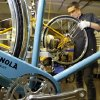 In a photo from April 10, 2013 in Detroit Alex Stchekine assembles a Shinola bicycle at the company\'s manufacturing facility. Detroit has a long history of making stuff _ cars, steel, even popcorn and is now home to a facility devoted to the production of wristwatches and bicycles. The frames are produced in Wisconsin and assembled in Detroit. (AP Photo/Carlos Osorio)