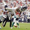 Photo -   Houston Texans running back Arian Foster (23) leaps into the end zone for a touchdown against the Miami Dolphins in the second quarter of an NFL football game, Sunday, Sept. 9, 2012, in Houston. (AP Photo/Eric Gay)